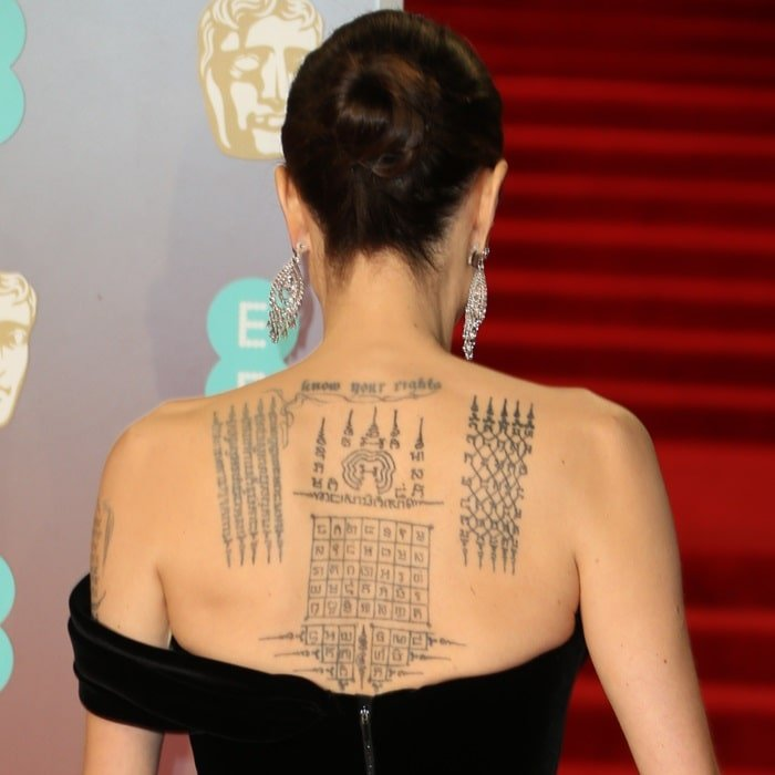 Angelina Jolie showing off her'protection' tattoos done by a Thai monk 'to symbolically bind her' with Brad Pitt