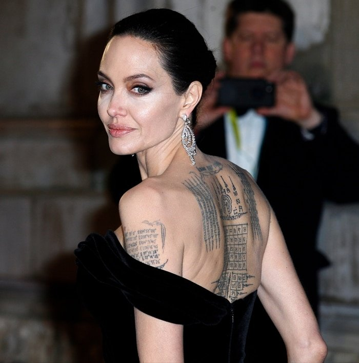 Angelina had the painful 'protection' tattoos done in February 2016, just months before her split with Brad Pitt