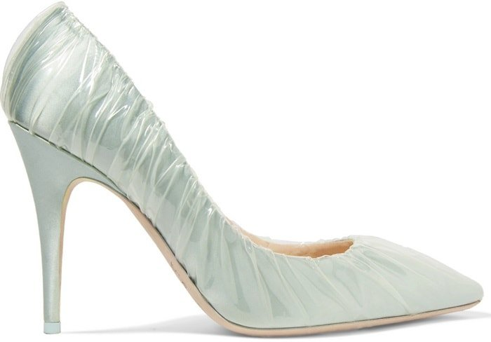 They have been made in Italy from light-blue satin and are covered with clear PVC to resemble glass slippers