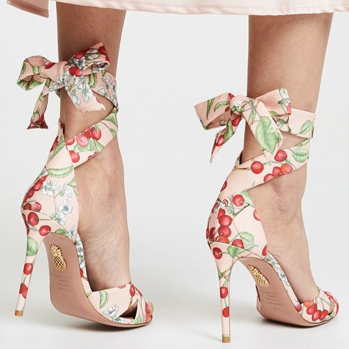 Crafted in Italy from canvas, this cherry blossom pattern pair is knotted at the toe and set on a 105mm slim heel