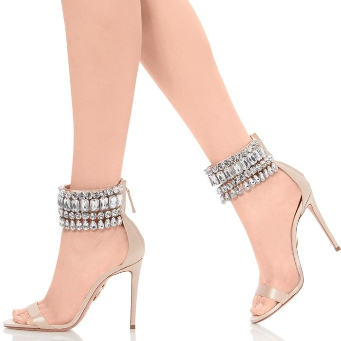It takes a forever sexy heeled sandal to new levels with an array of sparkling crystals at the ankle strap