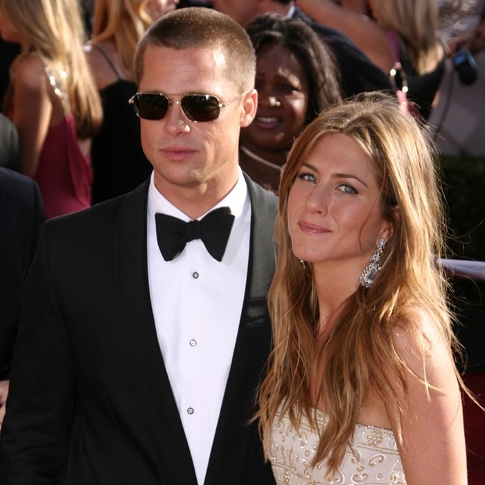 Brad Pitt and Jennifer Aniston arrive at the 56th Annual Primetime Emmy Awards at the Shrine Auditorium in Los Angeles on September 19, 2004