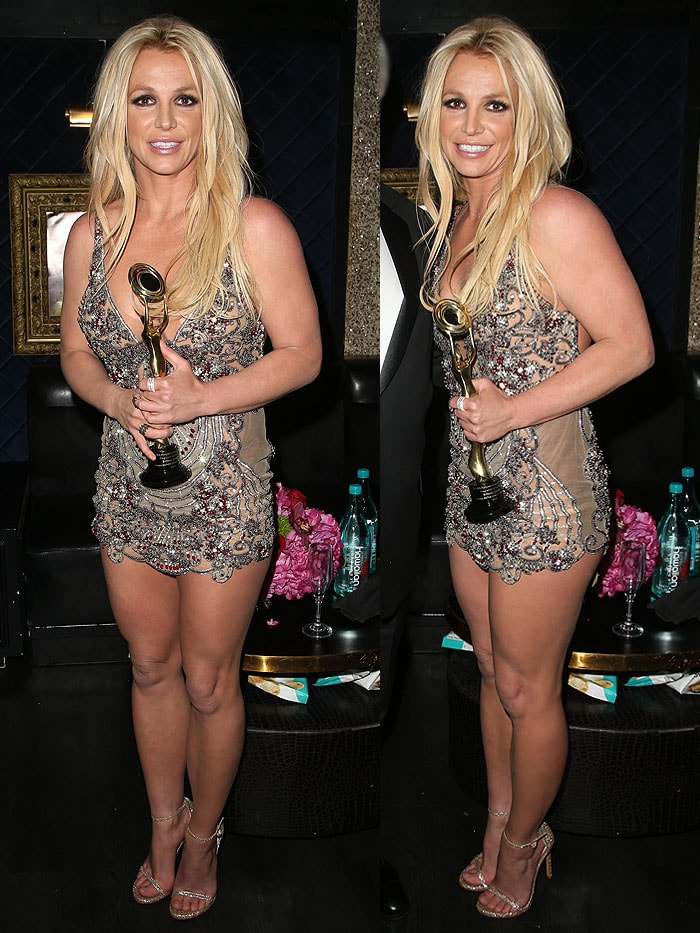 Britney Spears wearing an embellished mini dress with sparkly gold Stuart Weitzman 'Nudist' sandals.