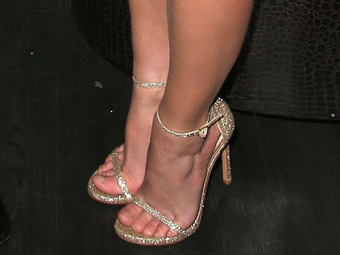 "Britney Spears's feet in sparkly gold Stuart Weitzman ""Nudist"" sandals"