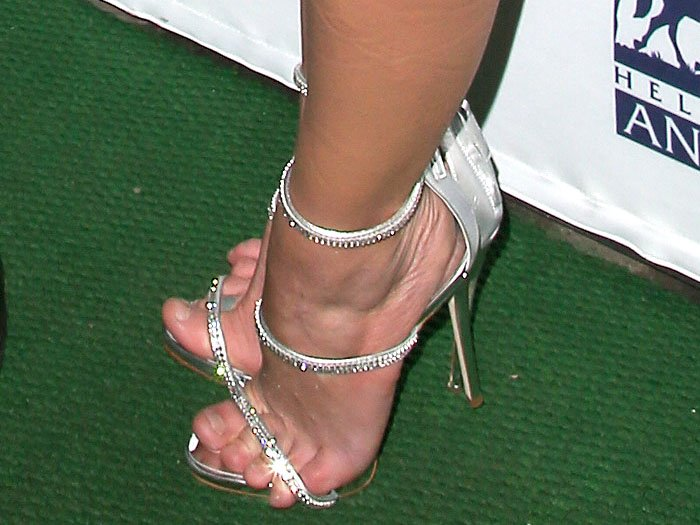Britney Spears' toes cannot be contained in her Giuseppe Zanotti sandals.