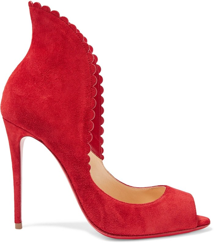 Crafted in Italy, this chic red pair is defined by a pin-thin heel and scalloped edges that curve and flatter the foot