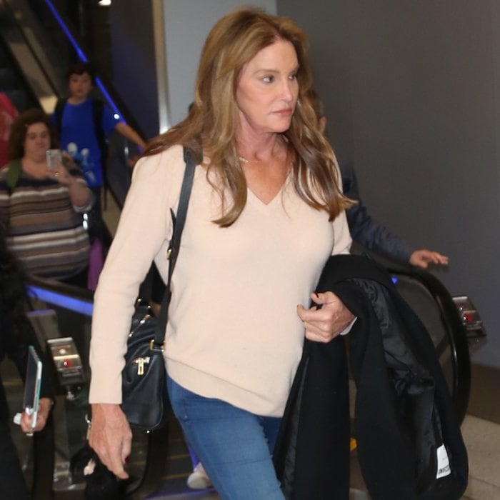 Caitlyn Jenner in a cozy cream jumper at Los Angeles International (LAX) Airport on March 10, 2018
