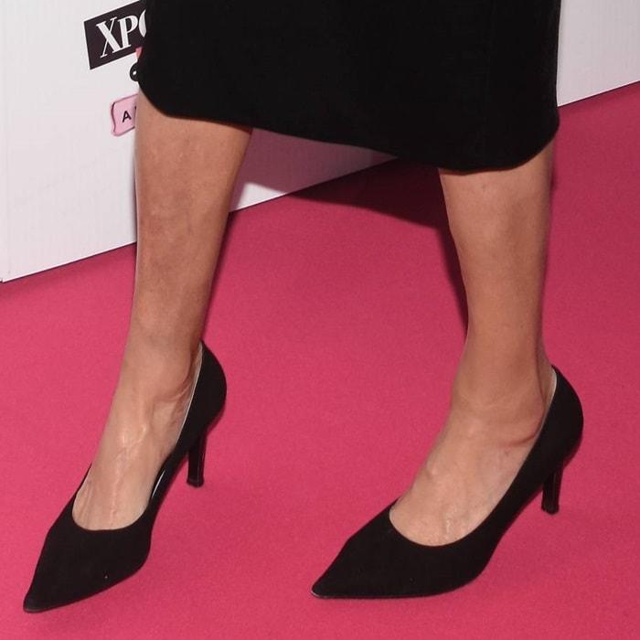Caitlyn Jenner wearing suede pointy-toe kitten heels