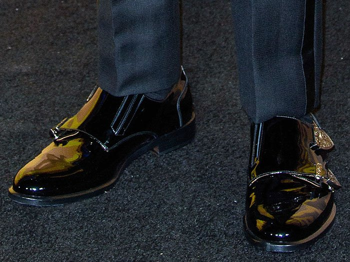 Chadwick Boseman's black-patent double-monk-strap shoes with embellished metal buckles.