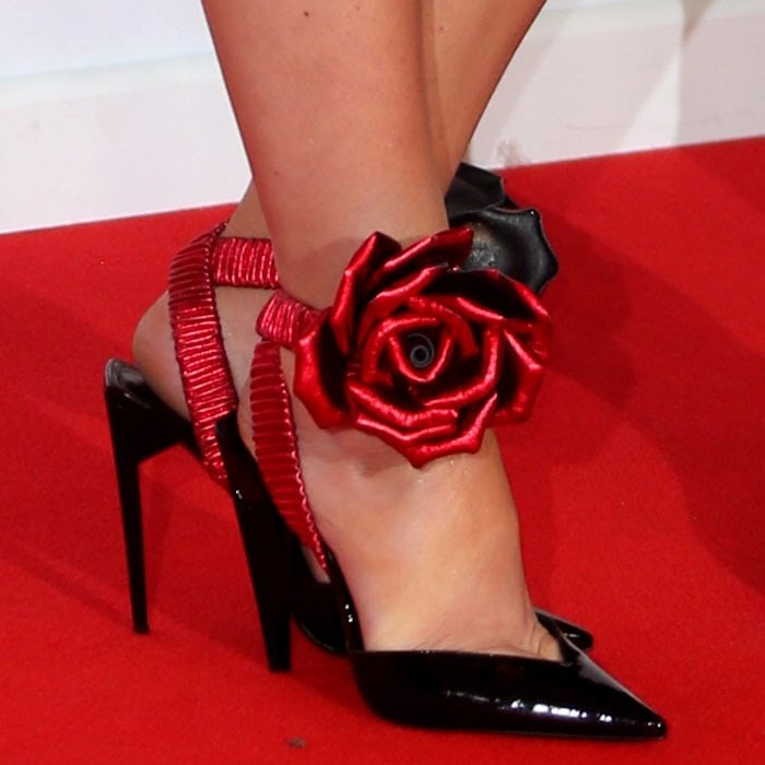 Cheryl Cole wearing Saint Laurent patent leather pump with oversized metallic rose detail