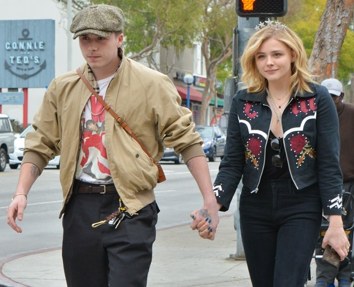 Chloë Grace Moretz styled her almond toe boots with a matching top and dark wash MOTHER ankle jeans