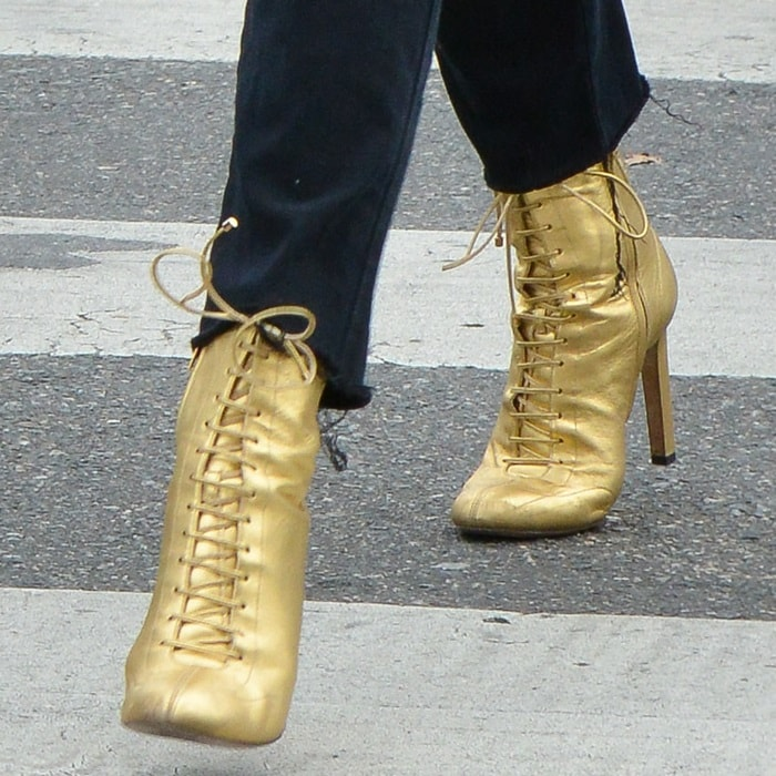 Chloë Grace Moretz wearing gold 'Daize' boots from Jimmy Choo's AW17 collection