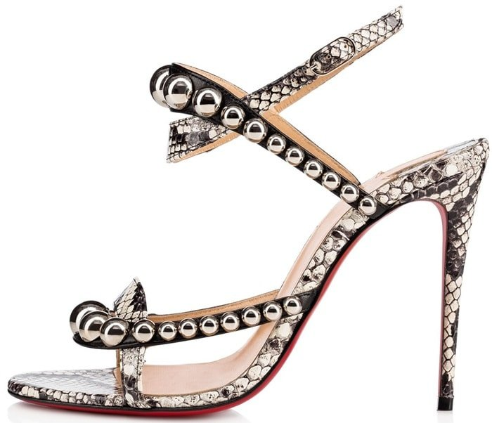 These peep-toe heels are crafted of black smooth leather and ivory and grey snakeskin