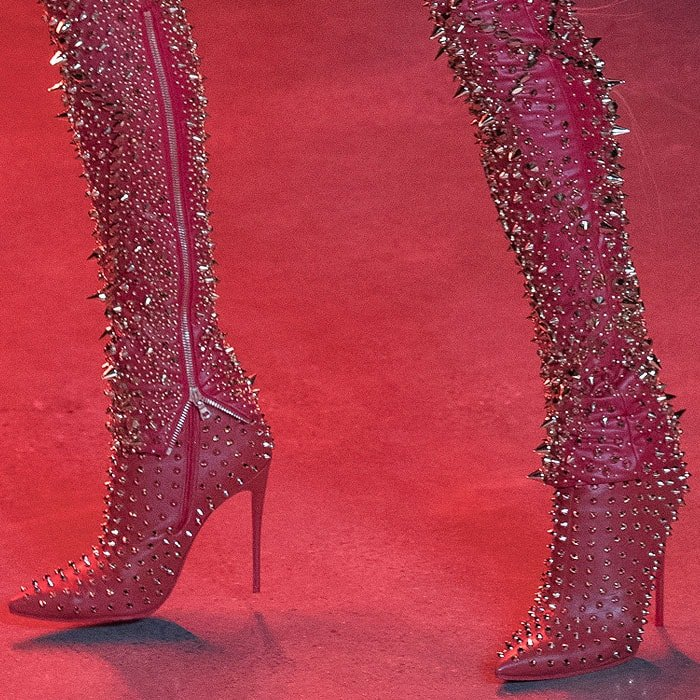 Spike-studded red leather booties