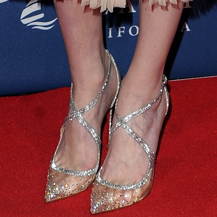 Eleanor Tomlinson shows off her feet in Christian Louboutin's 'Twistissima Strass' pumps