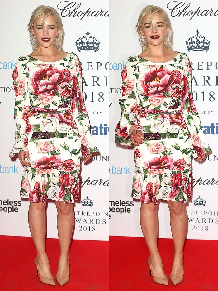Emilia Clarke wearing a Dolce & Gabbana floral-print dress with a flounce hem and sleeves paired with nude patent pumps.