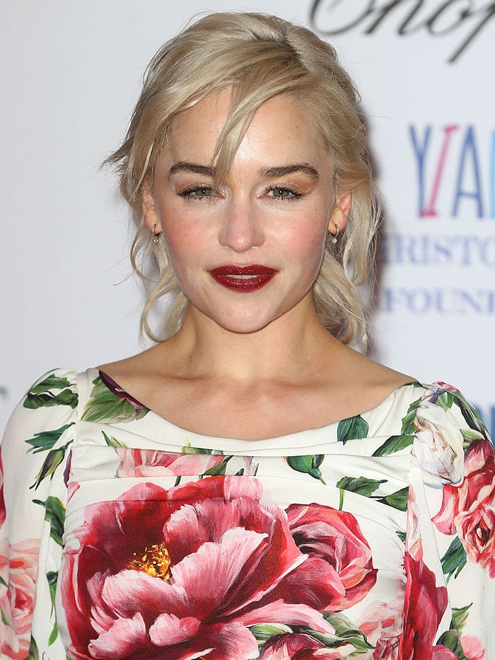 Emilia Clarke wearing a floral couch dress at the 2018 Centrepoint Awards held at Kensington Palace in London, England, on February 8, 2018