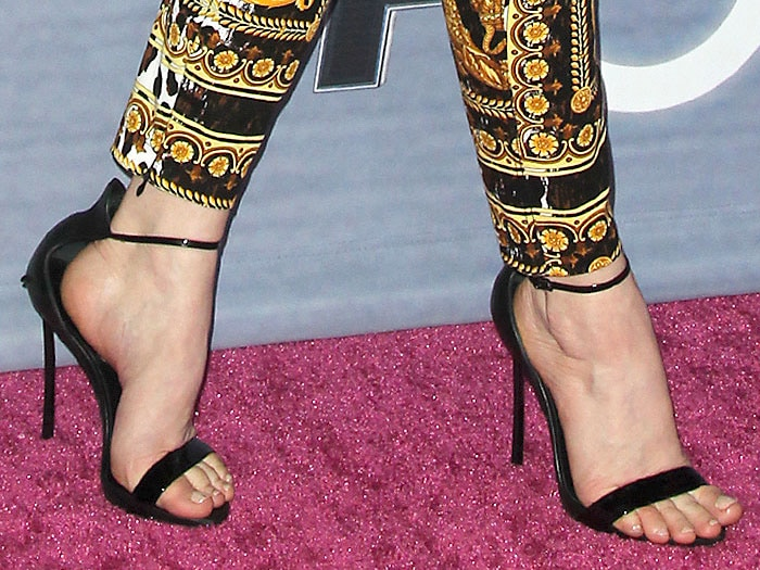 Fergie's feet in Casadei patent ankle-strap sandals