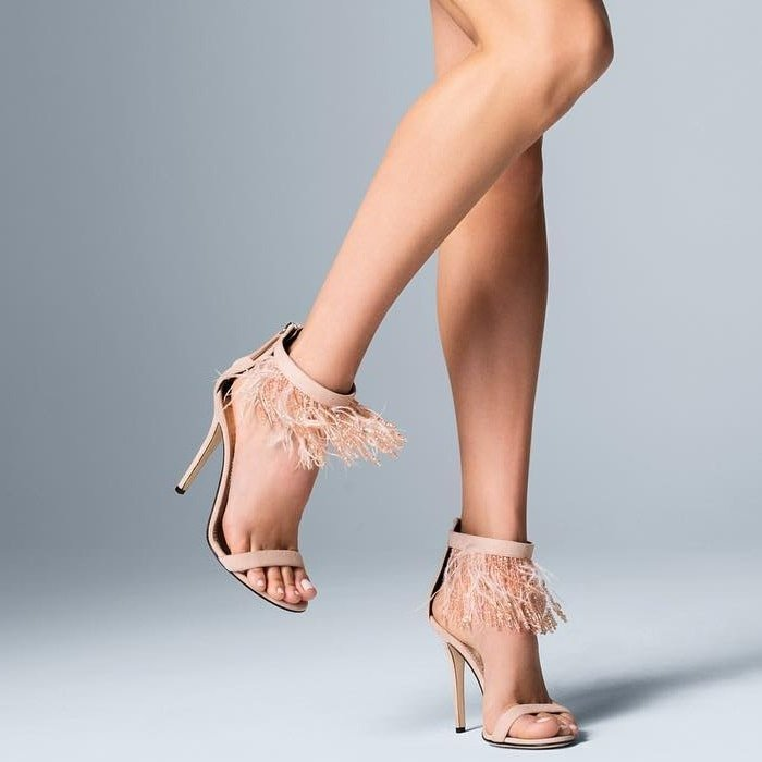 These pink sandals feature an open toe, a rear zip fastening, a high stiletto heel and a feather and bead trim fringe.