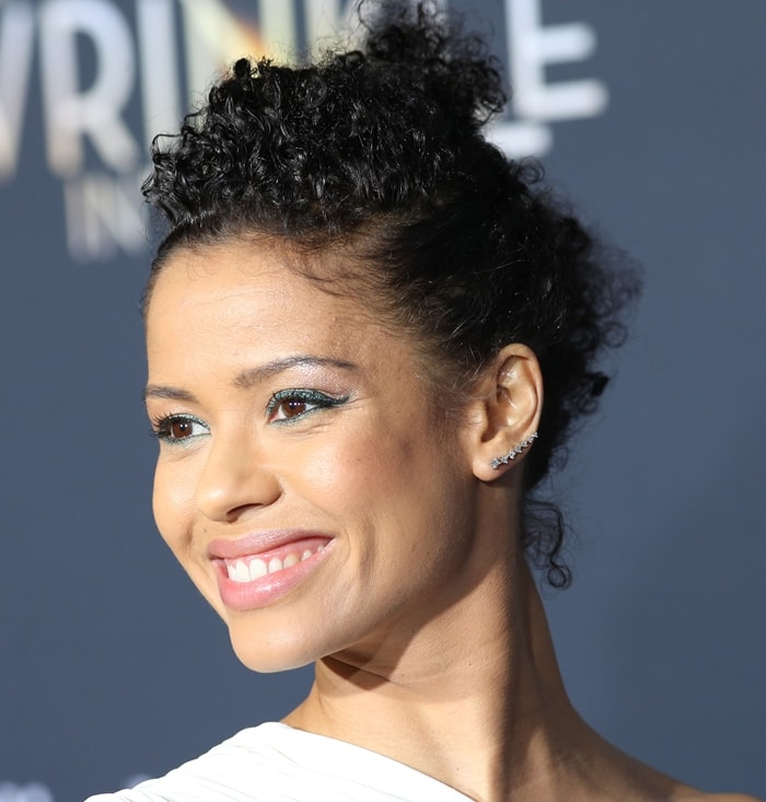 Gugu Mbatha-Raw kept her hair in a curly bun