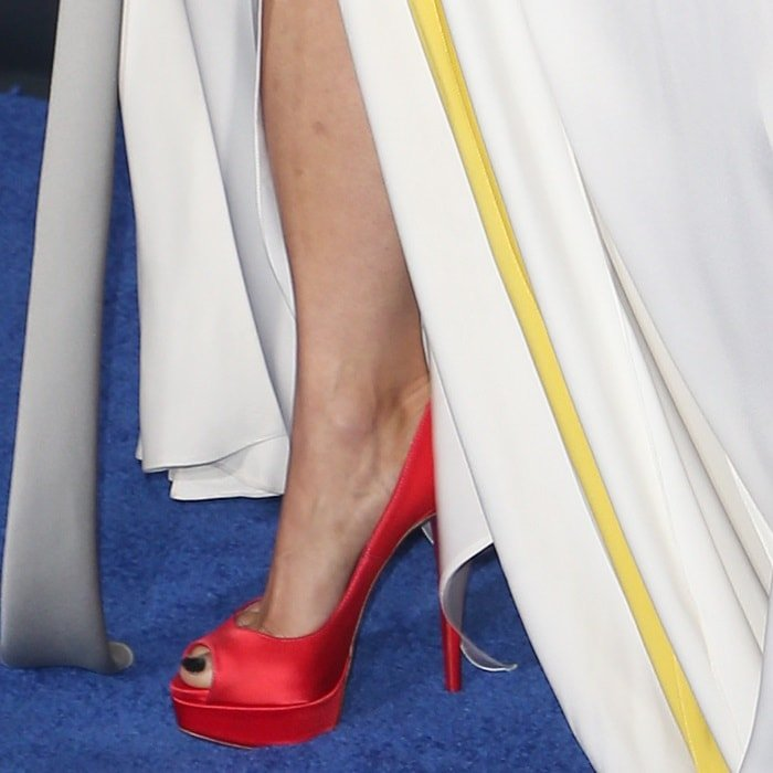 Gugu Mbatha-Raw showing off her feet in 'Lady Peep' platform pumps by Christian Louboutin