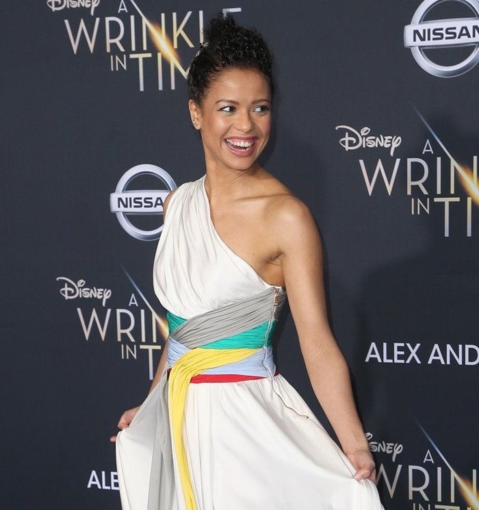 Gugu Mbatha-Raw wearing a white one-shoulder dress from the Vionnet Spring 2018 collection featuring pleated panels at the premiere of 'A Wrinkle in Time' at the El Capitan Theatre in Los Angeles on February 26, 2018