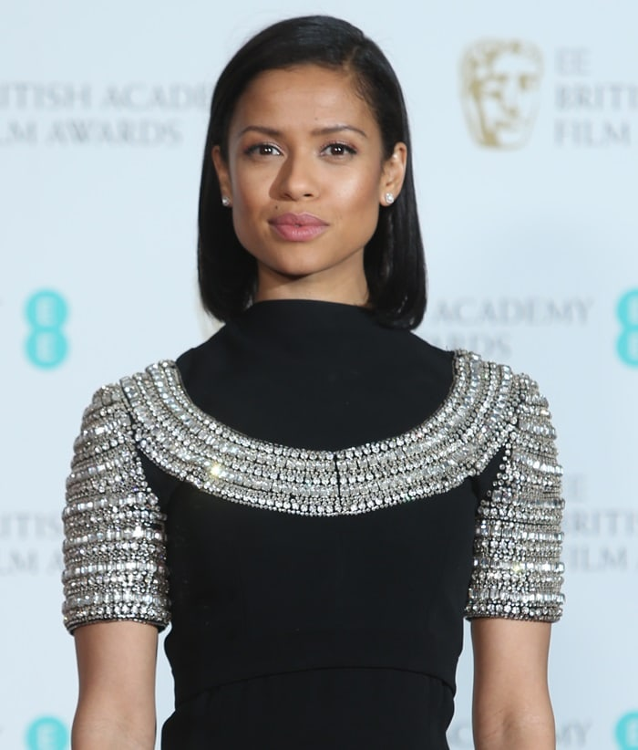 Gugu Mbatha-Raw wearing a vintage Cardinali dress at the 2018 EE British Academy Film Awards held at Royal Albert Hall in London, England, on February 18, 2018