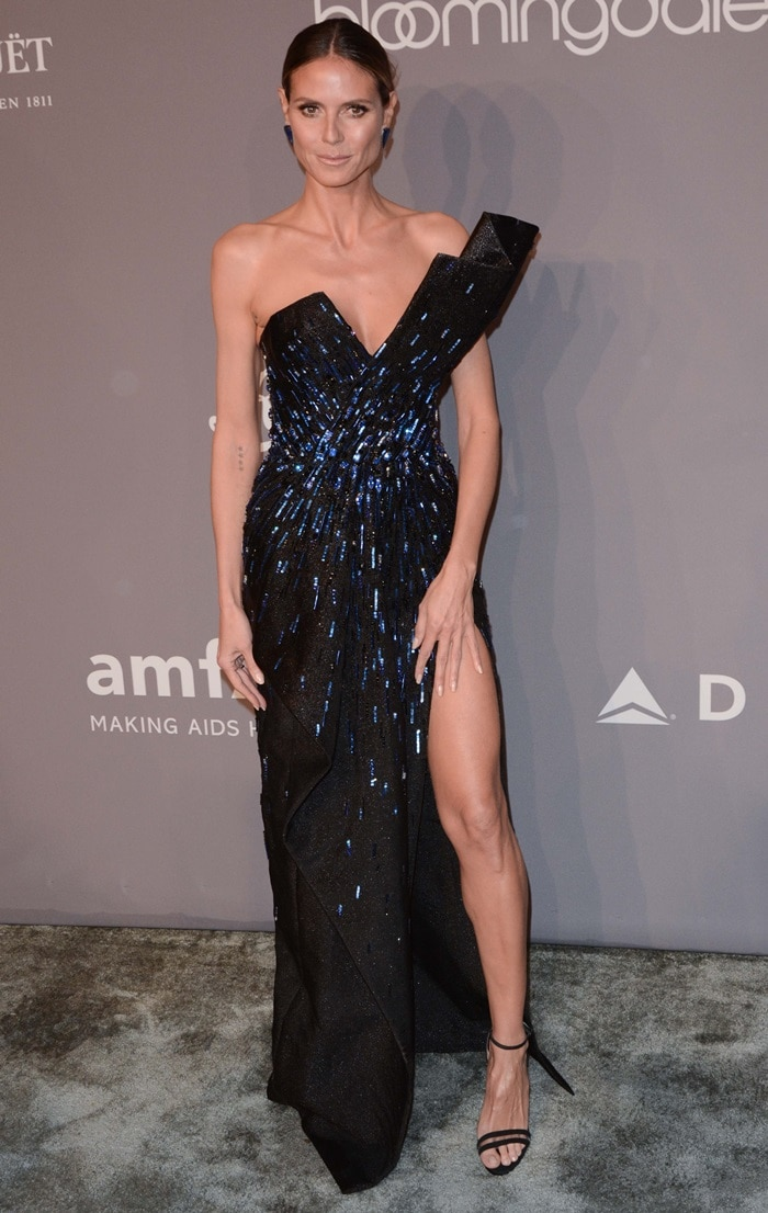 Heidi Klum wearing a black asymmetrical strapless gown from the Zuhair Murad Spring 2017 Couture Collection