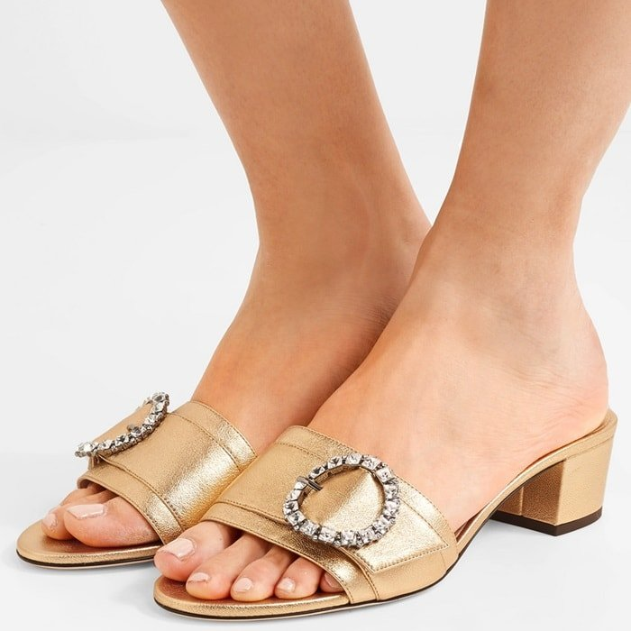 These slides are made from glossy gold textured-leather and topped with a round crystal buckle