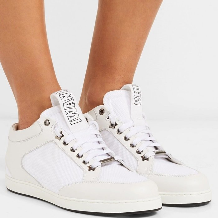 Jimmy Choo masters tongue-in-cheek with these 'Miami' sneakers – their grosgrain pull tabs are playfully printed with the words 'I Want' and 'Choo'. Made from white leather, they're paneled with waffled canvas and punctuated with burnished silver eyelets, stars and a designer-stamped plaque. The low-top shape looks so good with wide-leg pants or cropped jeans.