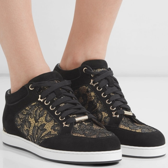 Jimmy Choo's 'Miami' sneakers have intricate floral-lace panels that are highlighted by the gold background. Made from soft black suede, they're finished with padded cuffs and a smooth leather lining to ensure comfort. Show yours off with cropped jeans.