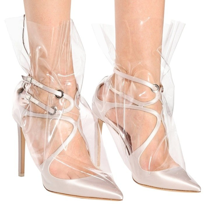 Fusing classic silhouettes with contemporary details, Jimmy Choo X Off-White's Claire 100 satin pumps are this season's ultimate statement design
