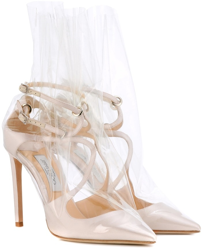 The strappy silhouette is crafted from pearlescent white satin and covered in transparent plastic wrapping for an urban-cool finish
