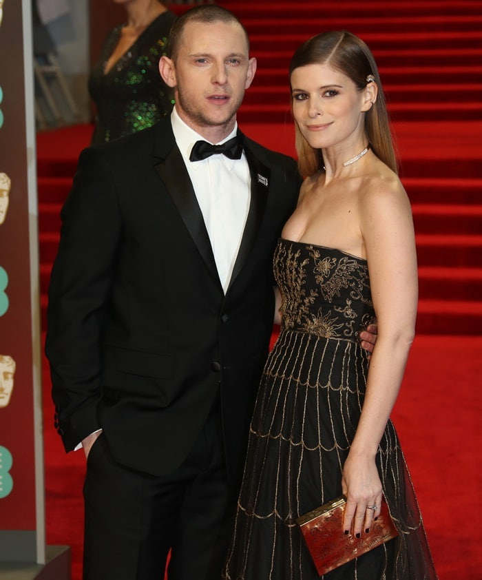 Jamie Bell and Kate Mara smiling to the cameras at the 2018 EE British Academy Film Awards held at Royal Albert Hall in London, England, on February 18, 2018