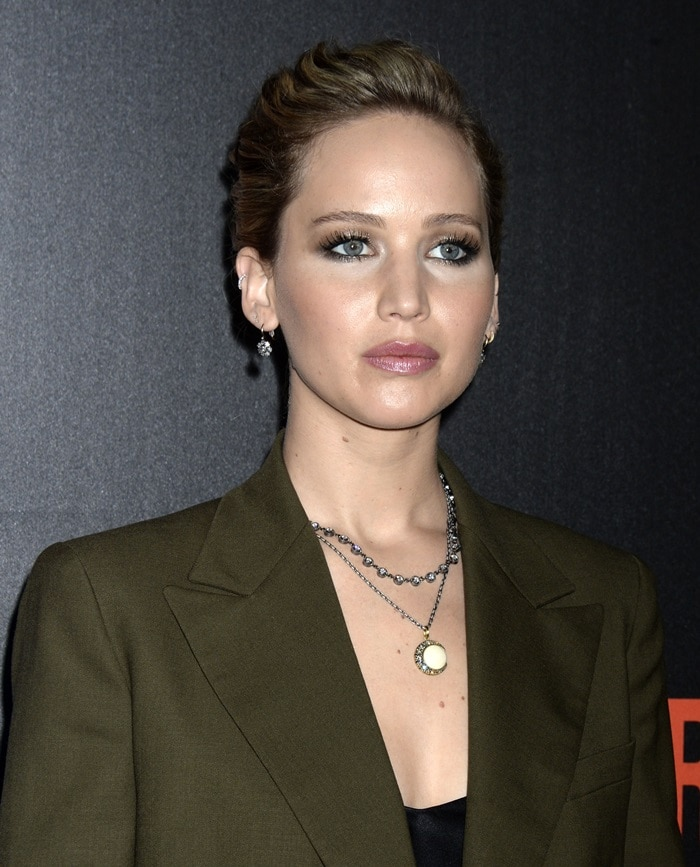 Jennifer Lawrence wearing a white stone crescent moon pendant by Sylva & Cie