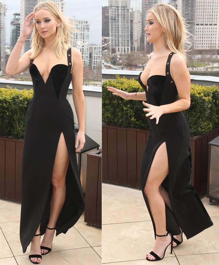Jennifer Lawrence wearingsilk cady column dress fromtheVersace Pre-Fall 2018 collection featuring gold medallion embellished straps and sweetheart neckline