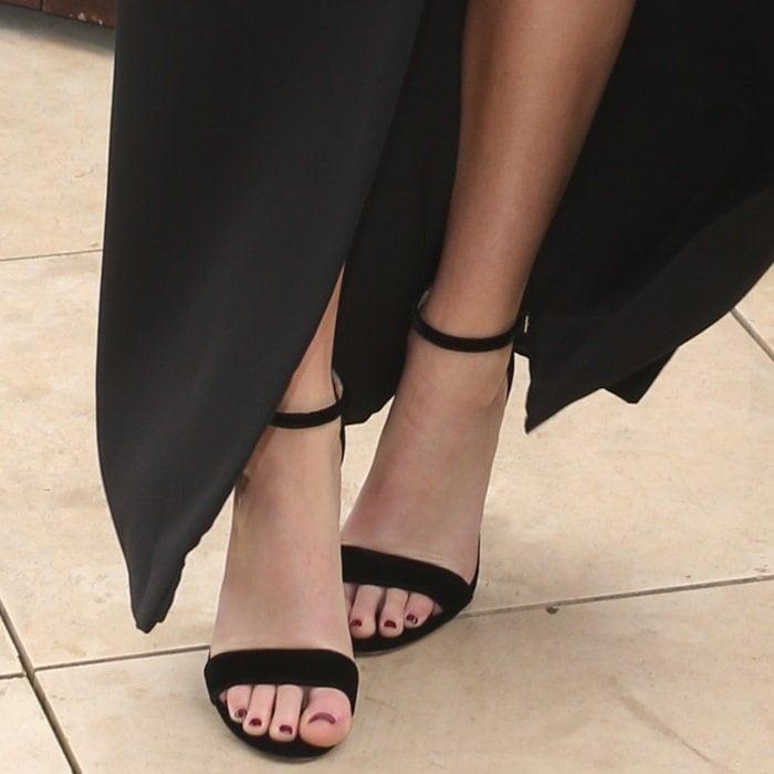 Jennifer Lawrence showing off her feet in black ankle-strap sandals
