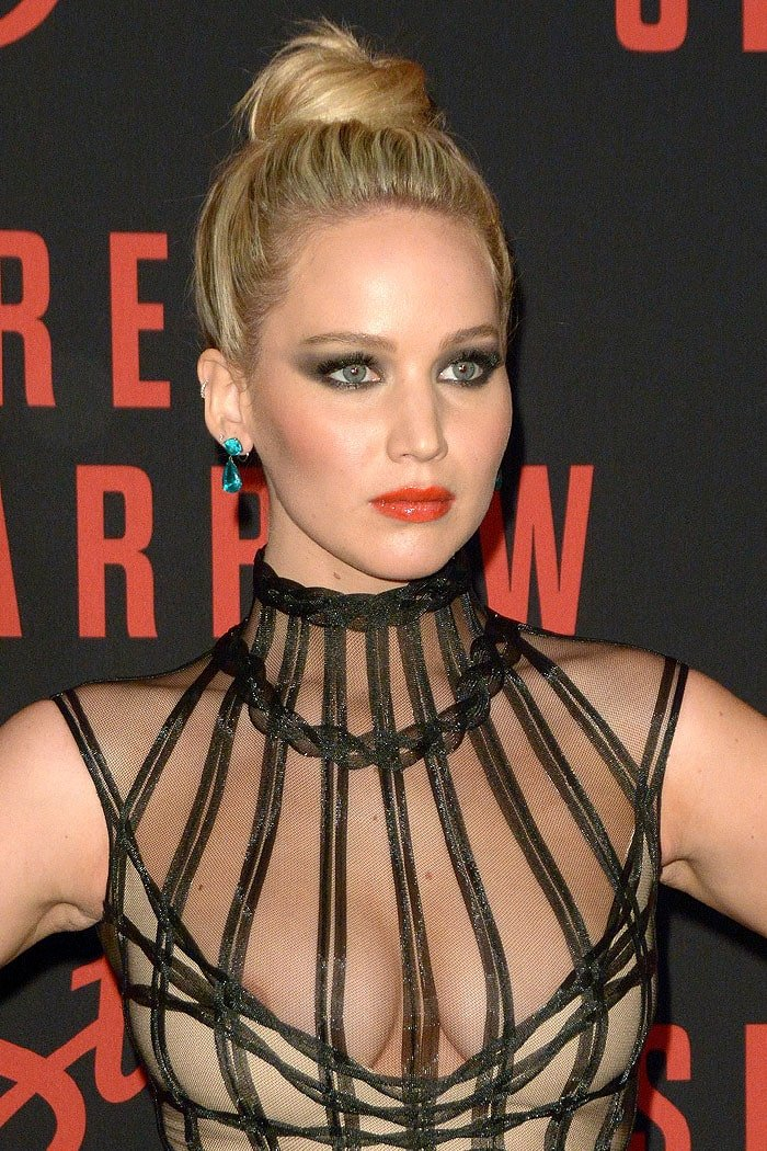 Jennifer Lawrence flashing a nipple in a sheer black dress.