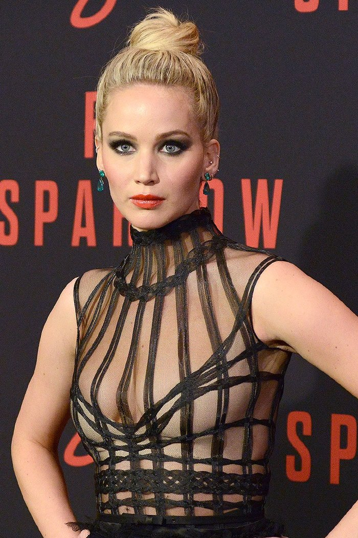 Jennifer Lawrence wearing a sheer black Dior gown with Lorraine Schwartz jewelry.