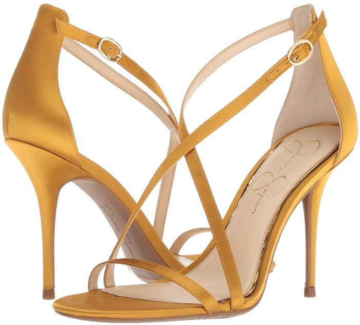 Slim straps crisscross on a stiletto sandal that channels modern glamour