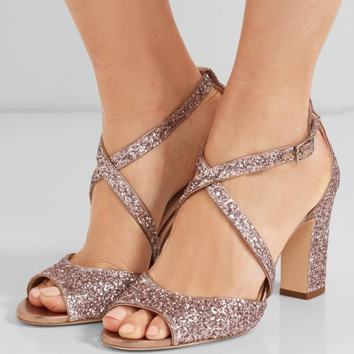 This pair from Jimmy Choo is made from supple leather and saturated with flecks of antique-rose glitter