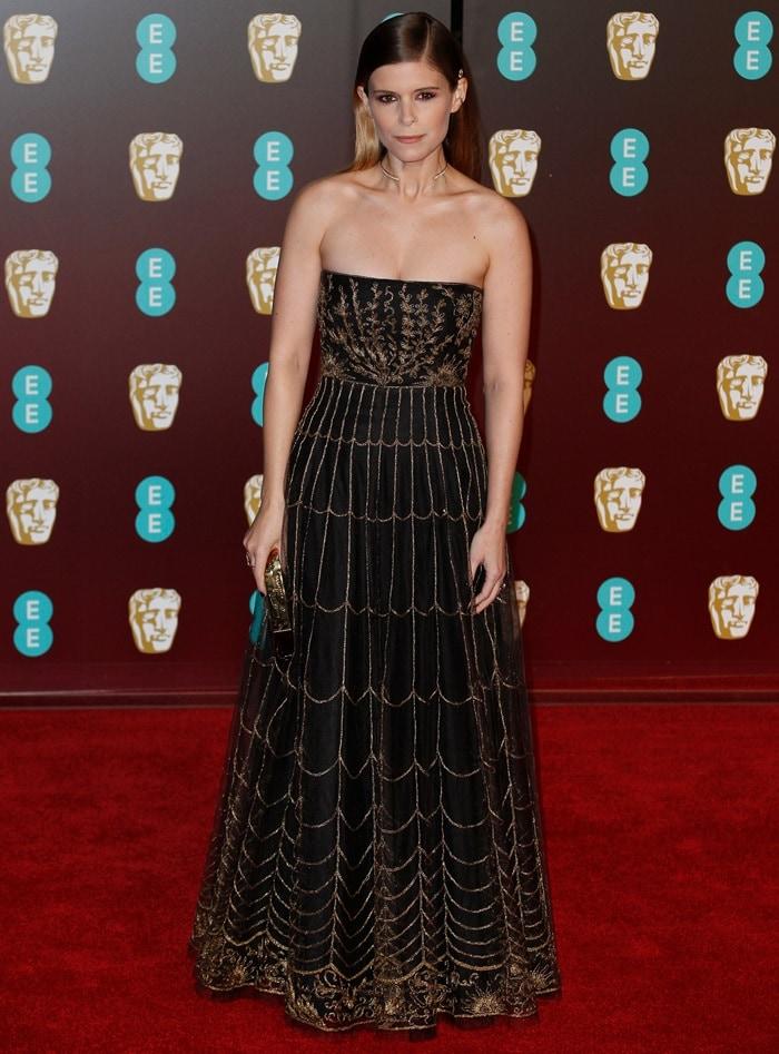 Kate Mara wearinga Christian Dior Fall 2017 Couture dress, a Lelet hair pin and Jennifer Fisher jewelry