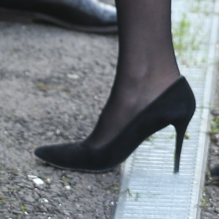 Catherine, Duchess Of Cambridge (aka Kate Middleton) gets her high heel stuck in the grill