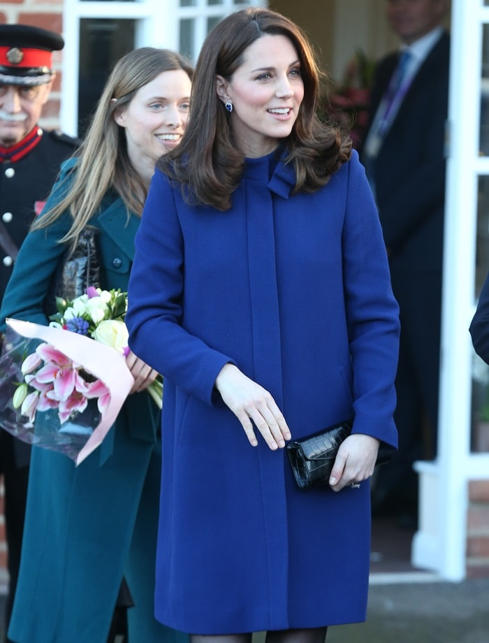 Catherine, Duchess Of Cambridge (aka Kate Middleton) wearing a marine blue Goat coat while greeting visitors at the opening of the Action On Addiction Community Treatment Centre in Wickford, England, on February 7, 2018
