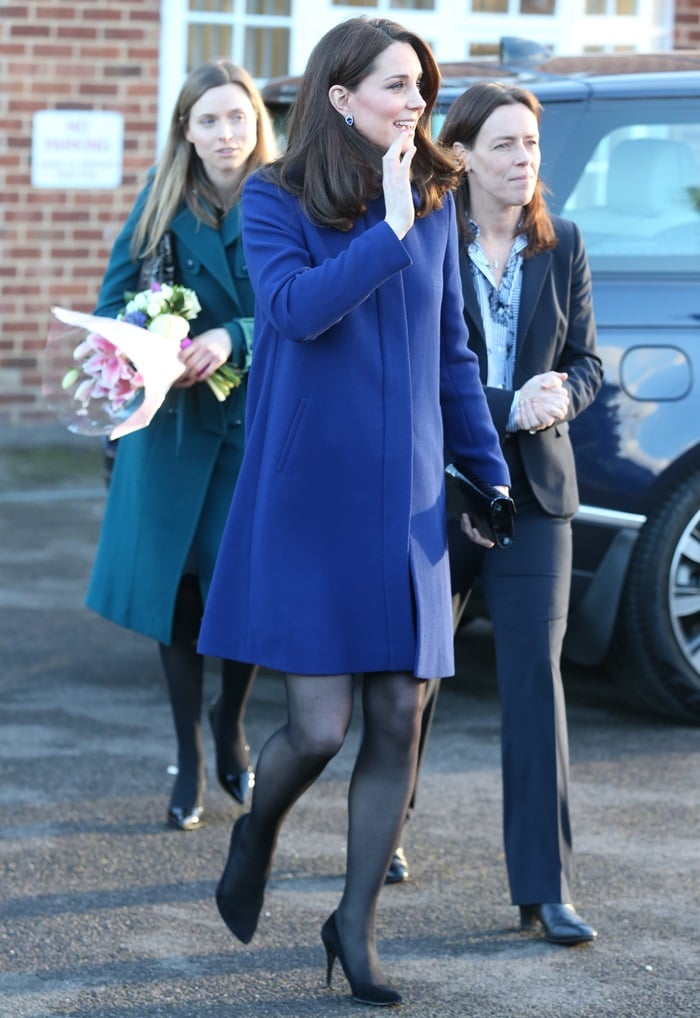 Catherine, Duchess Of Cambridge (aka Kate Middleton) greeted her fans ina blue Goat coat styled with a limited edition 'Blue Heart' clutch in black croc and her favorite 'Power' pumps from Stuart Weitzman