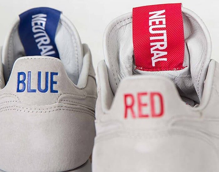"The ""BLUE"" and ""RED"" texts and corresponding ""NEUTRAL"" tongue tags on the Kendrick Lamar x Reebok 'Classic Leather' sneakers."