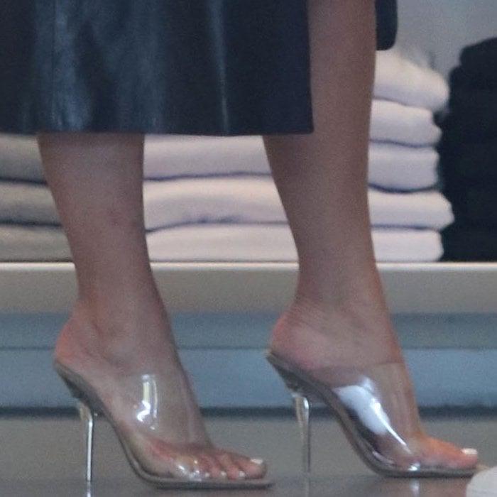 Kim Kardashian torturing her feet in Yeezy Season 6 PVC mules