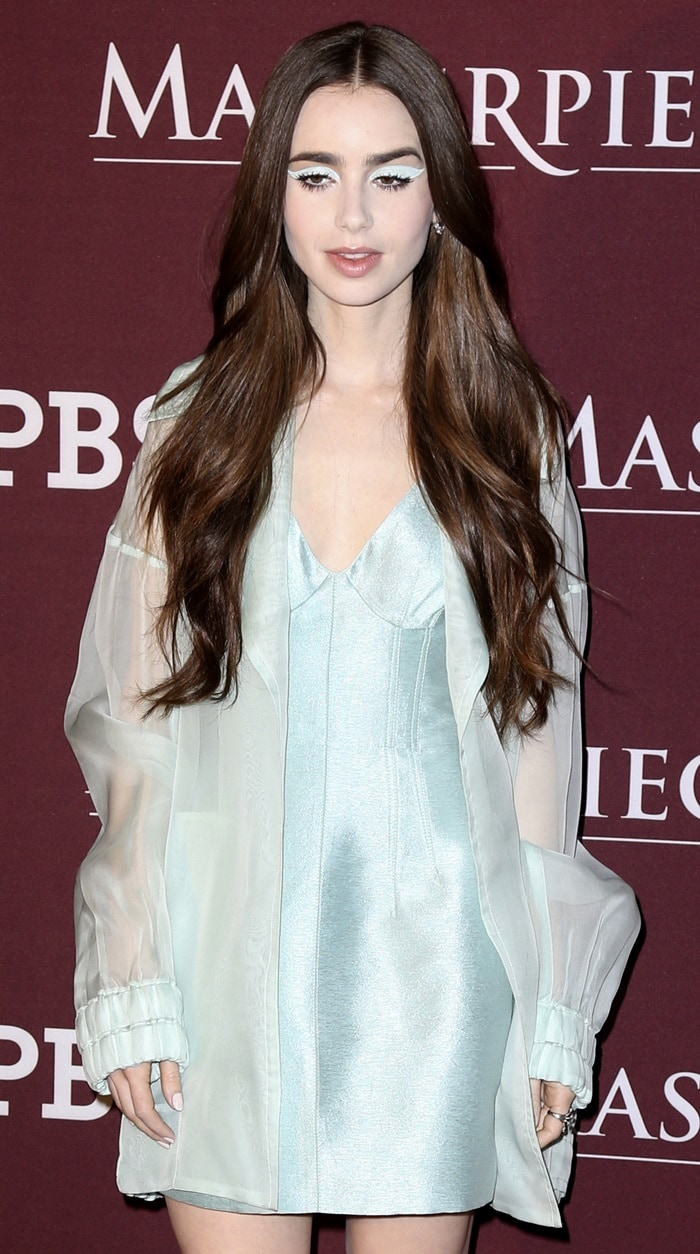 Lily Collins with frozen eyeshadow in an icy blue dress