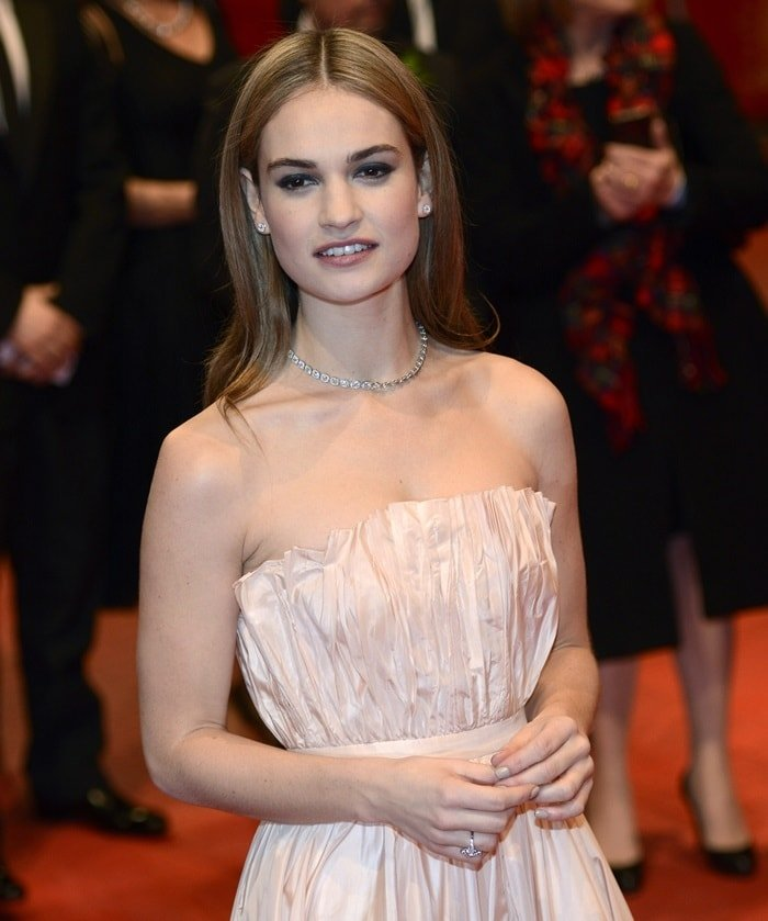Lily James wearing a ballet-pink silk Christian Dior gown and De Beers jewelry at the 'Cinderalla' premiere at Berlinale Palace during the 65th Berlinale International Film Festival in Berlin, Germany, on February 13, 2015