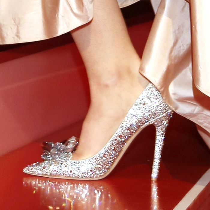 Lily James wearing sparkling Cinderella shoes from Jimmy Choo